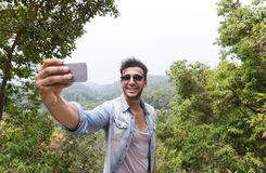 Hispanic Man Take Selfie Photo Over Mountain Landscape n Cell Smart Phone, Trekking Young Guy Tourist On Hike Royalty Free Stock Photography