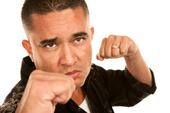 Hispanic Man Throwing Punch Stock Image