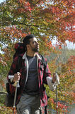 Hispanic Man with Trekking Poles and Backpack Stock Photo