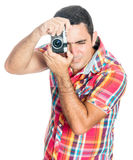 Hispanic man using a vintage looking compact camera Royalty Free Stock Photography