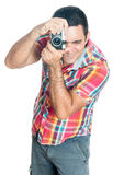 Hispanic man using a vintage looking compact camera Stock Images