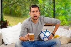 Hispanic man wearing denim jeans with grey sweater Stock Photography