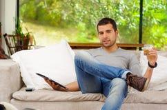 Hispanic man wearing denim jeans and grey sweater Royalty Free Stock Images