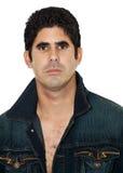 Hispanic man wearing an open denim jacket. Handsome young hispanic man wearing an open denim jacket isolated on white Stock Photos