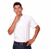 Hispanic man in white t-shirt looking reflective. Royalty Free Stock Images
