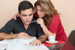 Hispanic man and woman studying at home Stock Photos