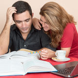 Hispanic man and woman studying at home Royalty Free Stock Image