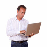 Hispanic man working with his laptop Royalty Free Stock Photo