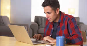 Hispanic man working on laptop Stock Images