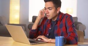 Hispanic man working on laptop Royalty Free Stock Image