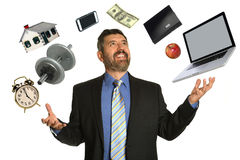 Mature Businessman Juggling. Hispanic mature businessman confidently juggling multiple objects stock image