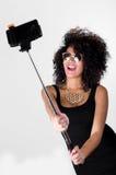 Hispanic model wearing sexy black dress, wild Stock Photos