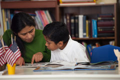 Hispanic Mom and Boy in Home-school Environment Studying Rocks Stock Image
