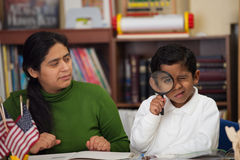 Hispanic Mom and Boy in Home-school Environment Studying Rocks Stock Photography