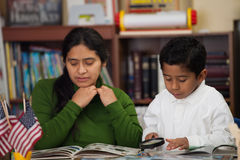 Hispanic Mom and Boy in Home-school Environment Studying Rocks Royalty Free Stock Images