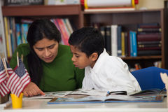 Hispanic Mom and Boy in Home-school Environment Studying Rocks Royalty Free Stock Photos