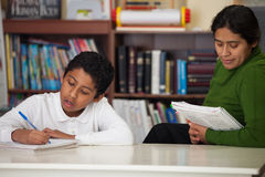 Hispanic Mom and Boy in Home-school Setting. Hispanic Mom and Boy in Home-school Environment stock images