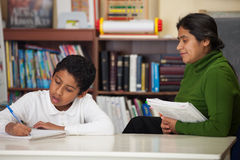 Hispanic Mom and Boy in Home-school Setting Royalty Free Stock Photos