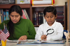Hispanic Mom and Boy in Home-school Setting Royalty Free Stock Images