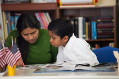 Hispanic Mom and Boy in Home-school Setting Studying Rocks. At Class stock images