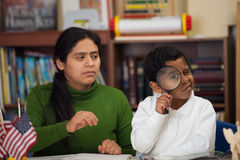 Hispanic Mom and Boy in Home-school Setting Studying Rocks. Hispanic Mom and Boy in Home-school Environment Studying Rocks royalty free stock photos