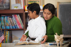 Hispanic Mom and Boy in Home-school Setting During Worship. Before Class royalty free stock photo