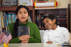 Hispanic Mom and Boy in Home-school Setting During Worship Stock Photo