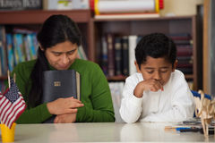Hispanic Mom and Boy Praying During Worship. Hispanic Mom and Boy in Home-school Setting During Worship stock photography