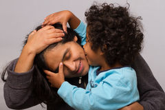 Hispanic Mom with Curly Hair Child Royalty Free Stock Images