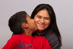 Hispanic Mom and her Child. On Gray Background Royalty Free Stock Photo