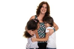 Hispanic mom with her two mixed race small girls. Multiracial family, Hispanic mom with her two mixed race small girls - Isolated on white stock photography