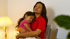 Hispanic mom waits in clinic waiting room for doctor to see sick stock footage