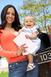Hispanic Mother And Baby Checking Mailbox Stock Photography