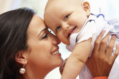 Hispanic mother and baby at home Stock Images