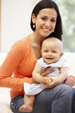 Hispanic mother and baby at home Stock Photos