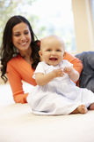 Hispanic mother and baby at home Royalty Free Stock Photos