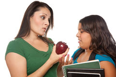 Hispanic Mother and Daughter with Books & Apple. Hispanic Mother and Daughter with Books and Apple Ready for School Isolated on a White Background Royalty Free Stock Photography