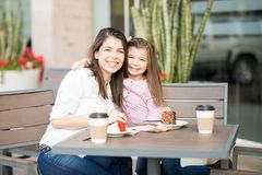Hispanic mother and daughter in a cafe Royalty Free Stock Photo