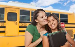 Hispanic Mother and Daughter Near School Bus. Proud Hispanic Mother and Daughter Next to a School Bus royalty free stock images