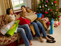 Hispanic mother and daughter resting. After Christmas shopping Stock Photos