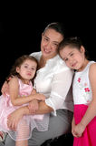 Hispanic Mother and Daughters. Isolated over a black background Royalty Free Stock Images