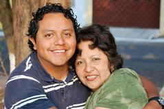 Hispanic mother and her grown son Royalty Free Stock Photo
