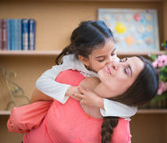 Hispanic mother and little daughter. Playing at home Royalty Free Stock Photo