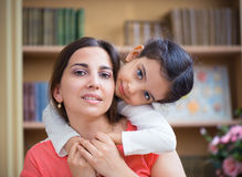 Hispanic mother and little daughter. Playing at home Stock Photos