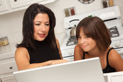 Hispanic Mother and Mixed Race Daughter on the Laptop Stock Photography