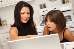 Hispanic Mother and Mixed Race Daughter on the Laptop Stock Images
