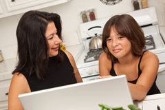 Hispanic Mother and Mixed Race Daughter on the Laptop Royalty Free Stock Photography