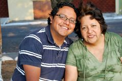 Hispanic Mother and son. Sitting together Stock Image