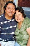 Hispanic Mother and son. Sitting together Stock Photos