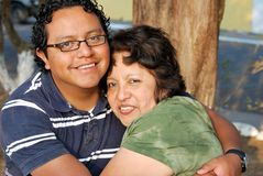Hispanic Mother and son. Sitting together Royalty Free Stock Images